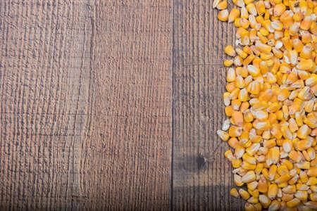 bordering: Whole yellow corn bordering side of wood panel