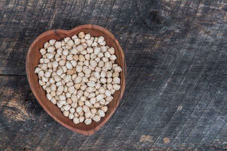 Chick peas in a heart shaped wooden bowl