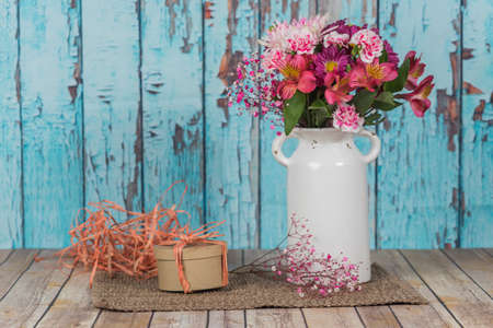 Crafting table decorated with a bouquet of flowers Stock Photo
