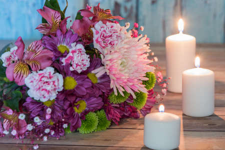 Bouquet of flowers surrounded by candles