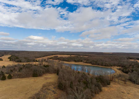 Aerial view of small lake in a wooded area