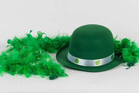 Green felt hat with feather boa for St. Patricks Day background Stock Photo