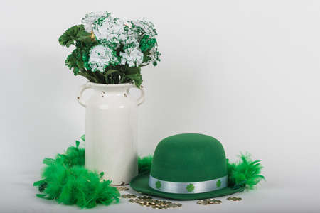 St. Patricks Day hat with vase of flowers and coins. Stock Photo