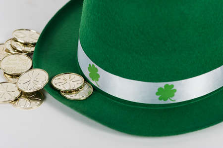 Close up of green hat with shamrocks and gold coins Stock Photo