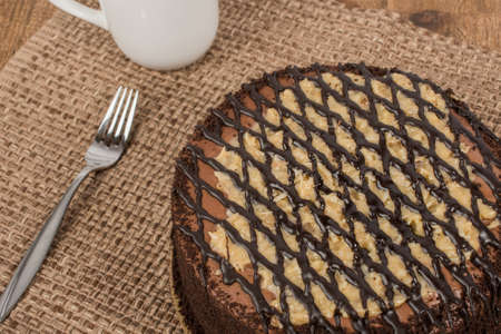 German Chocolate cake with fork and cup and rustic background Stock Photo