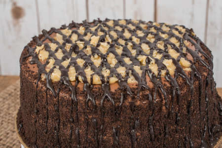 German Chocolate cake with wood background