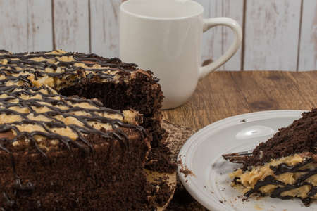 German chocolate cake with a slice removed Stock Photo