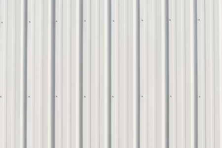 Gray metal siding close up with vertical lines for background