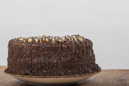 German Chocolate Cake with white background on wooden base