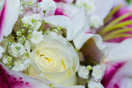 Close up of white roses and lilies
