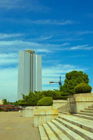 famous industries: Pyongyang, North Korea - August 2012: A building of Yanggakdo international hotel in Yanggakdo island