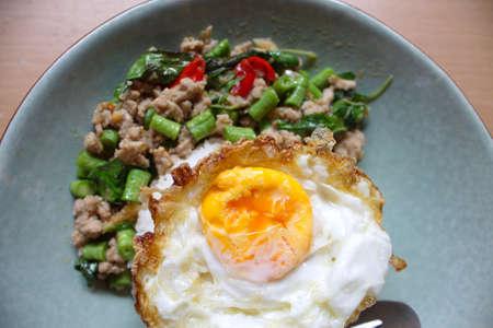 Pork with Thai basil and fried egg photo