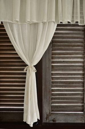 wood blinds: Old wood window with blinds.