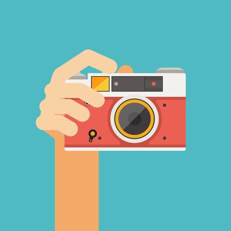 hand holding old camera Ilustração