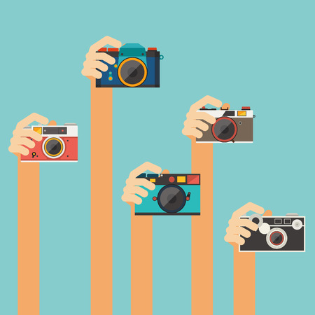 hand holding vintage camera vector