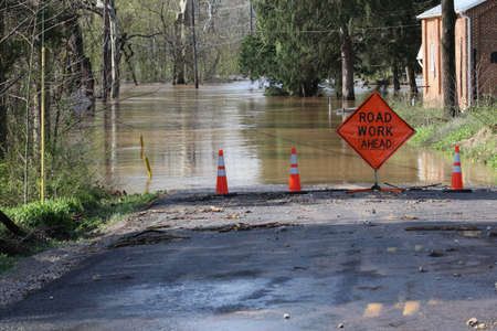 act of god: Flooded road with funny sign.