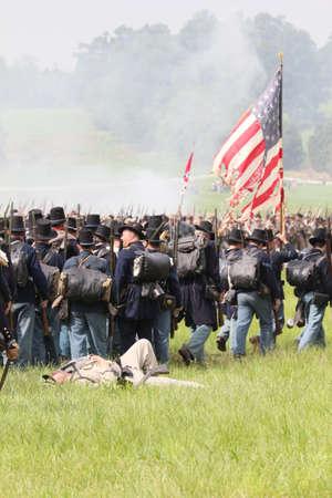 gettysburg: Union Civil War reenactors walk past a fallen Confederate solder at the 150th anniversary of the Battle of Gettysburg, June 28, 2013.