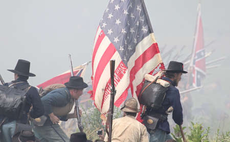 Union and Confederate flags at the 150th anniversary of the Battle of Gettysburg, June 28, 2013.