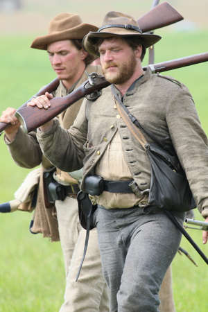 gettysburg: Two walking Confederate Civil War reenactors at the 150th anniversary of the Battle of Gettysburg, June 28, 2013.