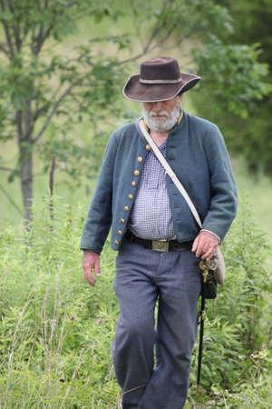 reenactor: Union Civil War reenactor walking in weeds at the 150th anniversary of the Battle of Gettysburg, June 28, 2013. Editorial