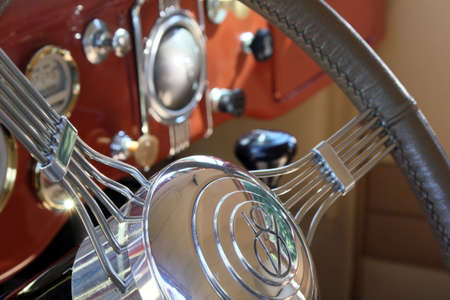 show time: Steering wheel and instrument cluster of a classic car. Stock Photo