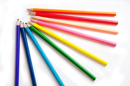 colored backgound: Isolated colored pencils symbolize bright rainbow  White backgound