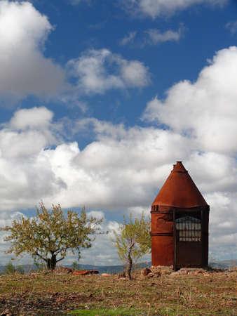 obsolescence: rusty metal hut in the field