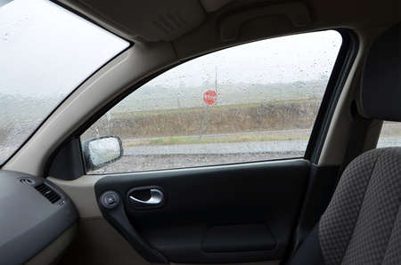 view from inside the car while it rains hard photo