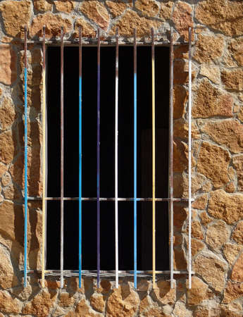 without window: multicolor old grating in a window without doors