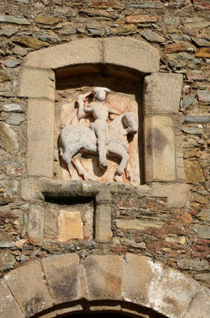 corresponds: Detail of the equestrian statue of Saint James the Moor-slayer, The arc Arco del Cubo (17th century), corresponds to the northern gate outside of the town of Zafra. In the tower is the equestrian statue of Saint James the Moor-slayer  in Zafra, Extremad Stock Photo