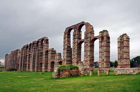 1st century ad: The Acueducto de los Milagros (Miraculous Aqueduct)is a ruined Roman aqueduct bridge built during the 1st century AD to supply water to the Roman colony of Emerita Augusta, today Merida, Spain. The aqueduct is preserved as part of the Archaeological Ensem Stock Photo