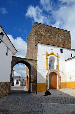 The arc Arco del Cubo (17th century), corresponds to the northern gate outside of the town of Zafra. In the tower is the equestrian statue of Saint James the Moor-slayer  in Zafra, Extremadura, Spain