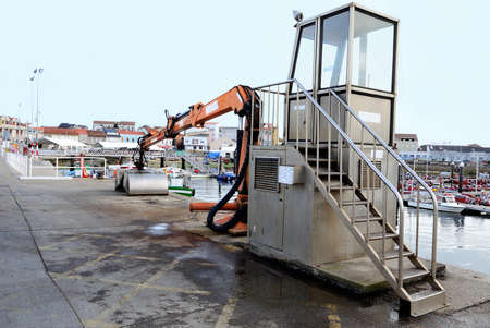 unloading: machine for unloading at a dock Stock Photo