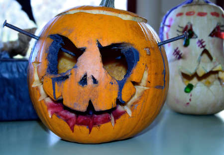 sinister: two sinister Halloween pumpkins decorated by hand