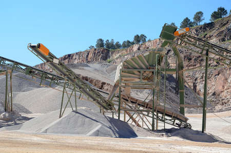 conveyor belt: gravel plant with conveyor belt and heaps of gravel Stock Photo