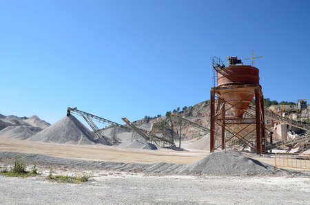 conveyor belt: gravel plant with conveyor belt and nozzle and heaps of gravel