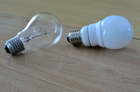 low energy: Old style incandescent light bulb next to a newer low energy type (compact fluorescent lamp-CFL)