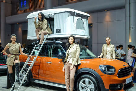 shiny car: Nonthaburi-Thailand MAR 30 201: Unidentified model with MINI Countryman on display at The 38th Bangkok International Motor Show 2017 on MAR 29 - 9 APR 2017 at IMPACT Challenger