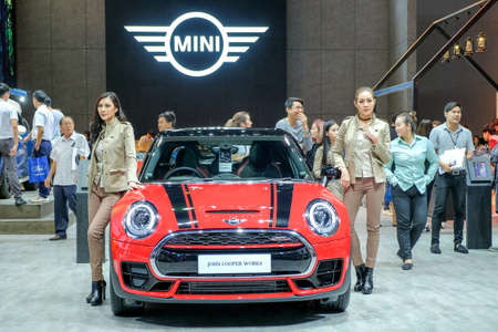 Nonthaburi-Thailand MAR 30 201: Unidentified model with MINI John Cooper Works Clubman on display at The 38th Bangkok International Motor Show 2017 on MAR 29 - 9 APR 2017 at IMPACT Challenger Muang Thong Thani Editorial
