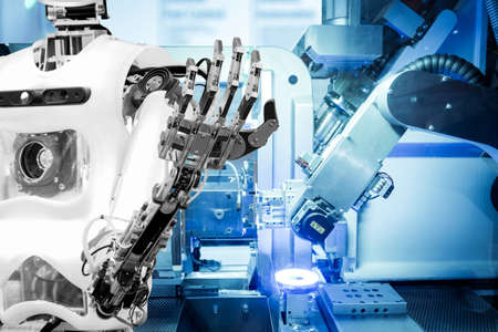 Artificial Intelligence on industrial robotics in blue tone color background, The robot has a role to work replacing humans in modern industries,   industry 4.0 concept