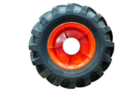 Industrial large tractor tires, isolated on white background Stock Photo