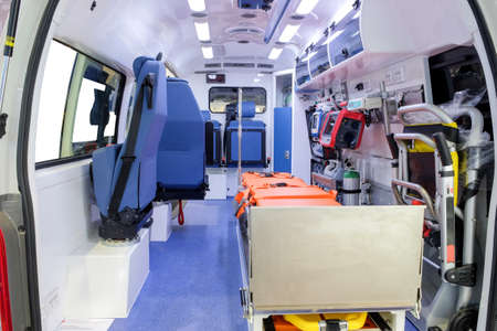 Inside an ambulance car with medical equipment for helping patients before delivery to the hospital.