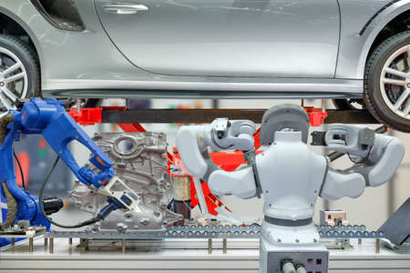 Industrial robotic installed 3D scan device to scanning auto parts for measuring data and robotic maintenance car to work automation on blurred control background, industry 4.0 concept