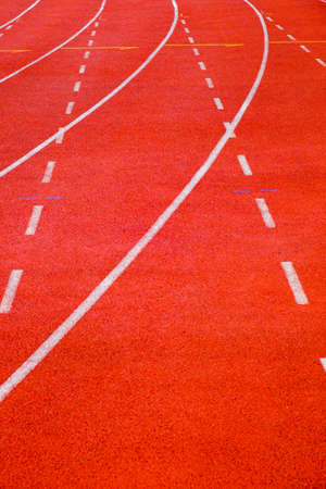 Close-up running track with curve and dash lines Archivio Fotografico