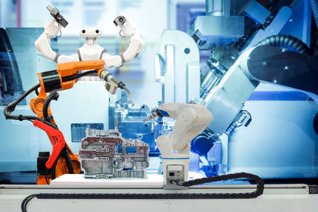 Industrial robotic welding, robot gripping and smart robot working on smart factory, on machine blue tone color background, industry 4.0 and technology, smart robotic working on teamwork concept Reklamní fotografie