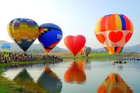 Chiang Rai-Thailand FEB 16 2017: People and tourists are watching hot-air balloon show at the Singha Park Chiang Rai International Balloon Fiesta, locate on Singha Park, Chiang Rai, Thailand Editorial