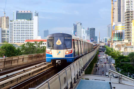 Bangkok-Thailand AUG 19 2019: BTS Sky Train on cityscape background in daytime , Sky Train is a mass transit system in Bangkok to assist facilitate and fast journey Redakční