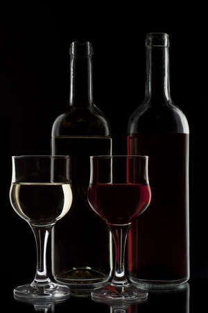 red and white wine in two glasses and two bottles photo