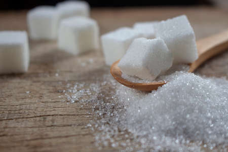 Sugar on wooden spoon, for healthy care article.