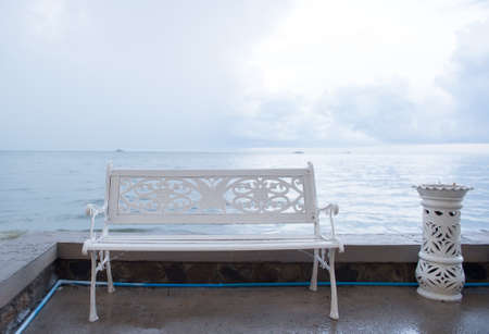 located: Art bench and ashtrays located on the beach